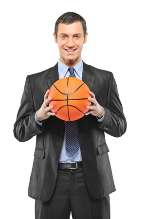 A smiling businessman holding a basketball isolated on white background photo