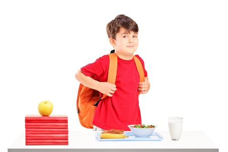 book bags: A schoolboy preparing for lunch isolated on white background