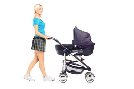 pram: Full length portrait of a mother pushing a baby stroller isolated on white background Stock Photo