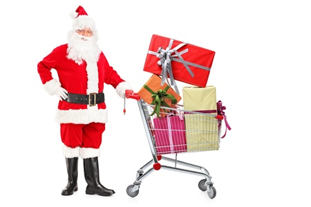Santa Claus pushing a shopping cart full of gifts isolated on white background
