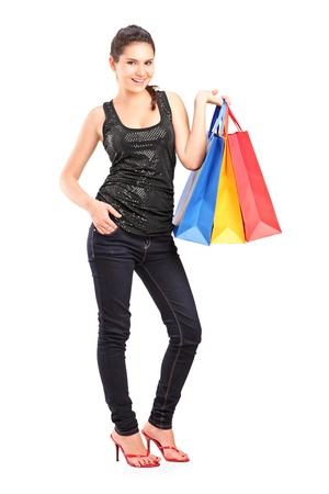 Full length portrait of a young female holding shopping bags isolated on white background Stock Photo - 16035146