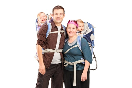 trek: Happy family with hiking backpacks posing isolated on white background