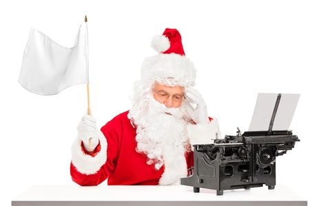 Disappointed Santa Claus with typing machine waving a white flag gesturing defeat photo