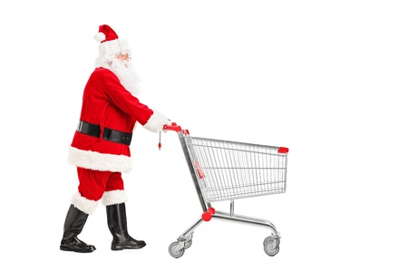 empujando: Pap� Noel que empuja un carro de compras vac�o aislado en el fondo blanco