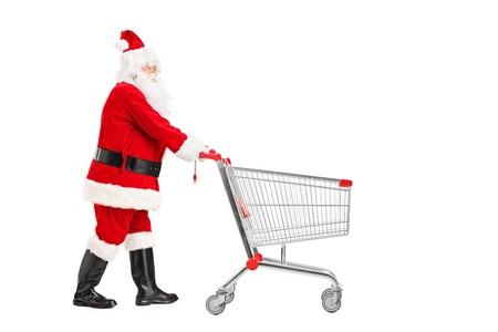 pushing: Santa Claus pushing an empty shopping cart isolated on white background Stock Photo