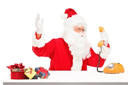 agitated: Nervous Santa Claus screaming on a telephone isolated on white background
