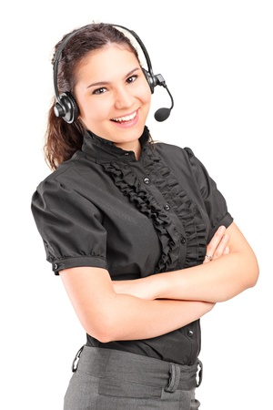 business woman standing: A smiling female customer support with headphones and microphone isolated on white background