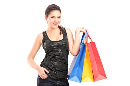 A young female holding shopping bags isolated on white background Stock Photo - 16243318