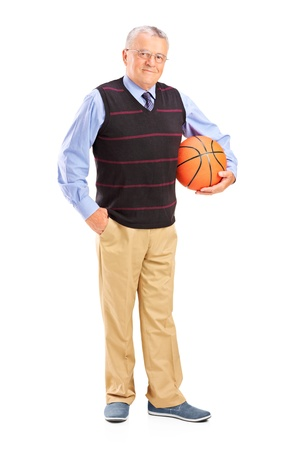 Full length portrait of a gentleman holding a basketball isolated against white background photo