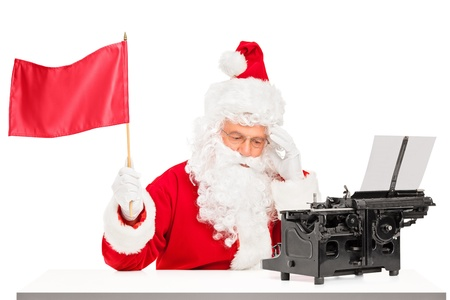 holiday stress: Thoughtful Santa Claus with typing machine waving a red flag gesturing defeat