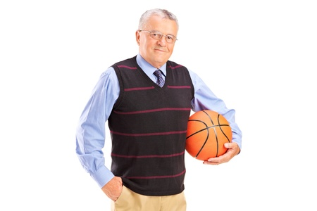 A gentleman holding a basketball isolated against white background photo