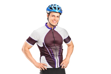 A male biker wearing helmet and posing isolated on white background photo