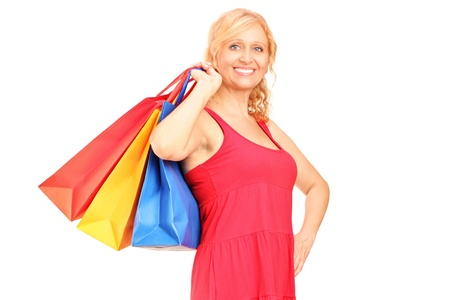 A mature woman holding shopping bags isolated on white background Stock Photo - 16320296