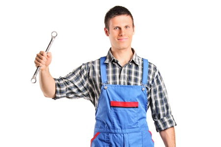 A repairman in overall holding a wrench and toolbox isolated on white background Stock Photo - 16320298