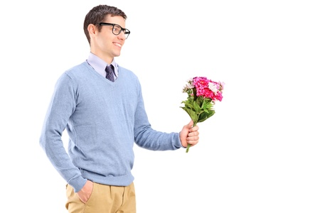 A young man holding flowers isolated on white background photo