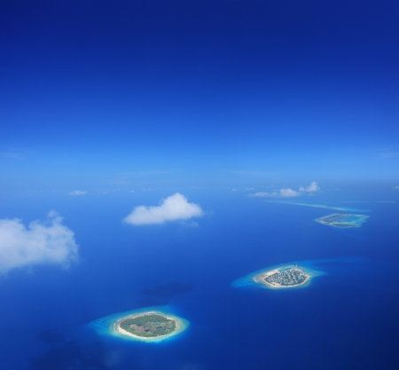 aerial views: Aerial view of Maldives islands in Indian ocean, shot with a tilt and shift lens Stock Photo