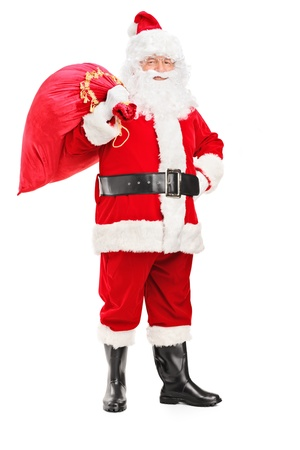 Full length portrait of a Santa Claus holding a bag full of gifts on his back isolated on white background photo
