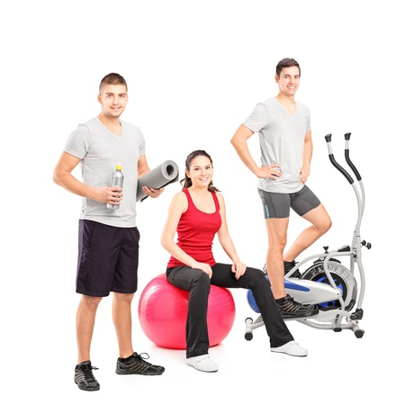 fit ball: Group of people at the gym posing isolated on white background