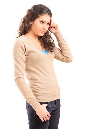 Sad female teenager isolated on white background Stock Photo - 16502474