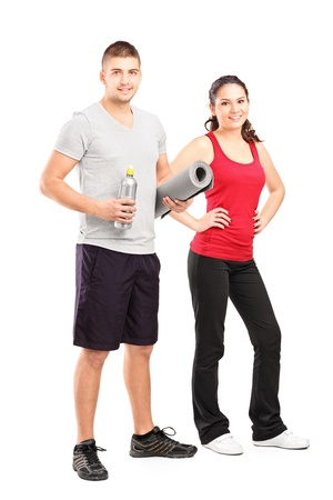 leisure wear: Full length portrait of a man and female athlete after an excerise isolated on white background