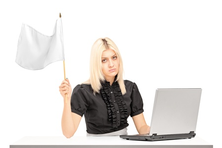 Sad female office worker waving a white flag gesturing defeat isolated on white background photo