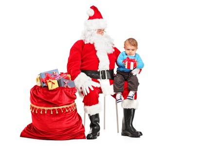 Santa Claus and child with a gift posing isolated against white background photo