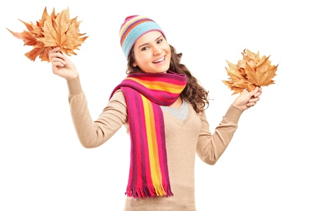 Young smiling female holding tree leaves in her hands isolated on white background Stock Photo - 16547501