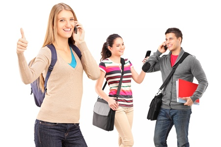 A happy male and female student using a mobile phones isolated on white background Stock Photo - 16547557