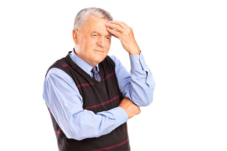 tension: Portrait of a mature man holding his head in pain isolated on white background