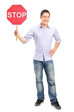 Full length portrait of a man holding a traffic sign stop isolated on white background Stock Photo - 16577904