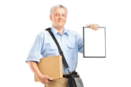 A delivery person holding a clipboard and box isolated against white background Stock Photo - 16639741