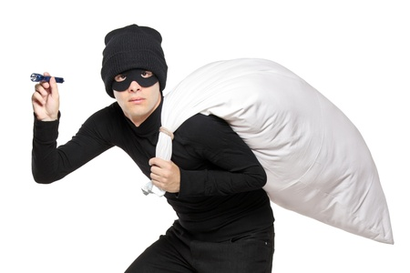 A robber with a bag on his back and flashlight isolated on white background photo