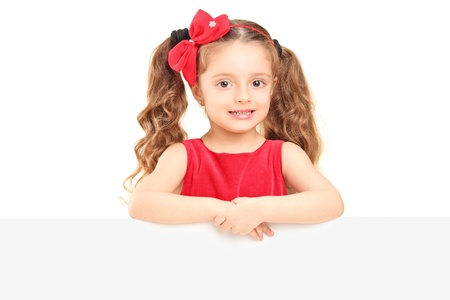 A small girl posing behind a blank panel Stock Photo - 16639711
