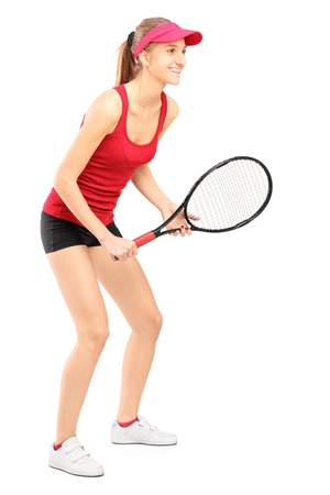 Full length portrait of female tennis player ready to play isolated on white background photo