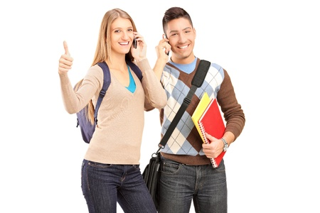 A happy students talking on a phone and giving thumb up isolated on white background Stock Photo - 16732384