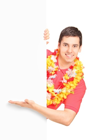 A portrait of a smiling man wearing hawaian costume and gesturing on a blank panel isolated on white background Stock Photo - 16757292