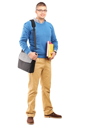 Full length portrait of a smiling male student with shoulder bag holding notebooks isolated on white background Stock Photo - 16757283