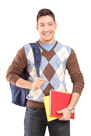 A handsome male student school bag holding books isolated against white background Stock Photo - 16810564
