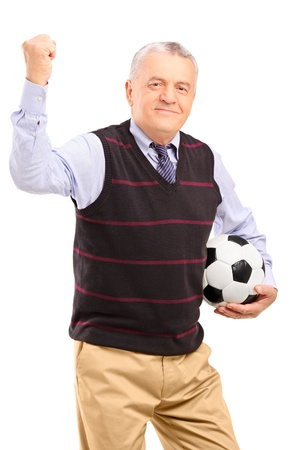 admirer: A happy mature fan with football gesturing with his hand isolated against white background