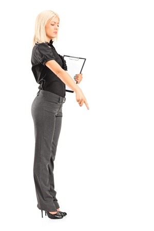 Full length portrait of a brutal woman manager gesturing with her finger, isolated against white background  photo