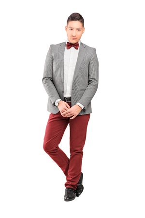 young male model: Full length portrait of a handsome stylish male posing isolated on white background