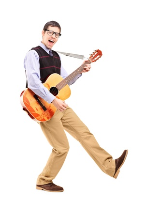 Full length portrait of a happy male playing a guitar isolated against white background photo