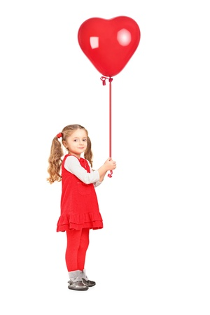 helium balloon: Full length portrait of a little girl holding a red heart shaped balloon isolated on white background