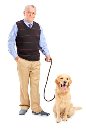 single man: Full length portrait of a smiling senior man posing with his pet isolated on white background Stock Photo