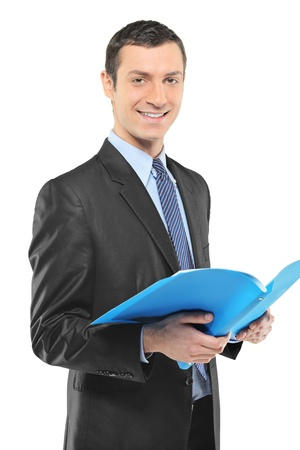 fascicule: A smiling businessman holding a document isolated on white background