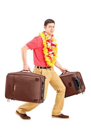 Full length portrait of a guy carrying very heavy travel bags and gesturing isolated on white background Stock Photo - 16882509