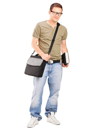 Full length portrait of a male student with shoulder bag holding a book isolated on white background Stock Photo - 16954842