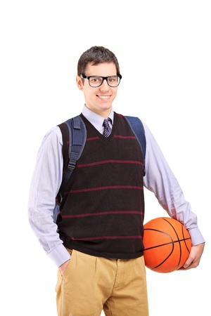 A smiling male student with school bag holding a basketball isolated on white background photo
