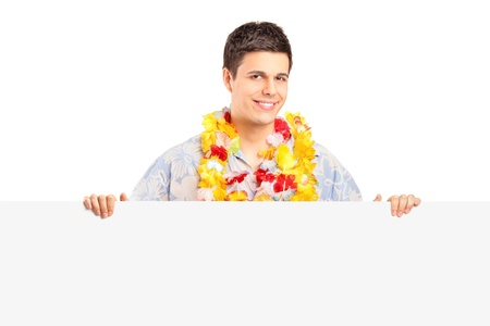 Smiling man wearing hawaian costume on a blank panel isolated on white background Stock Photo - 16981254