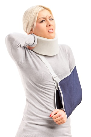 broken arm: A blond woman with broken arm and injured neck suffering from a pain isolated on white background